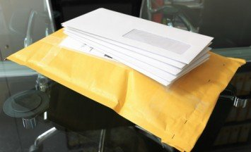 pile of paper mails over parcel post in office